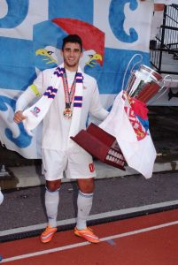 All's well that ends well.... Milos Scepanovic celebrates championship victory with Serbian White Eagles.